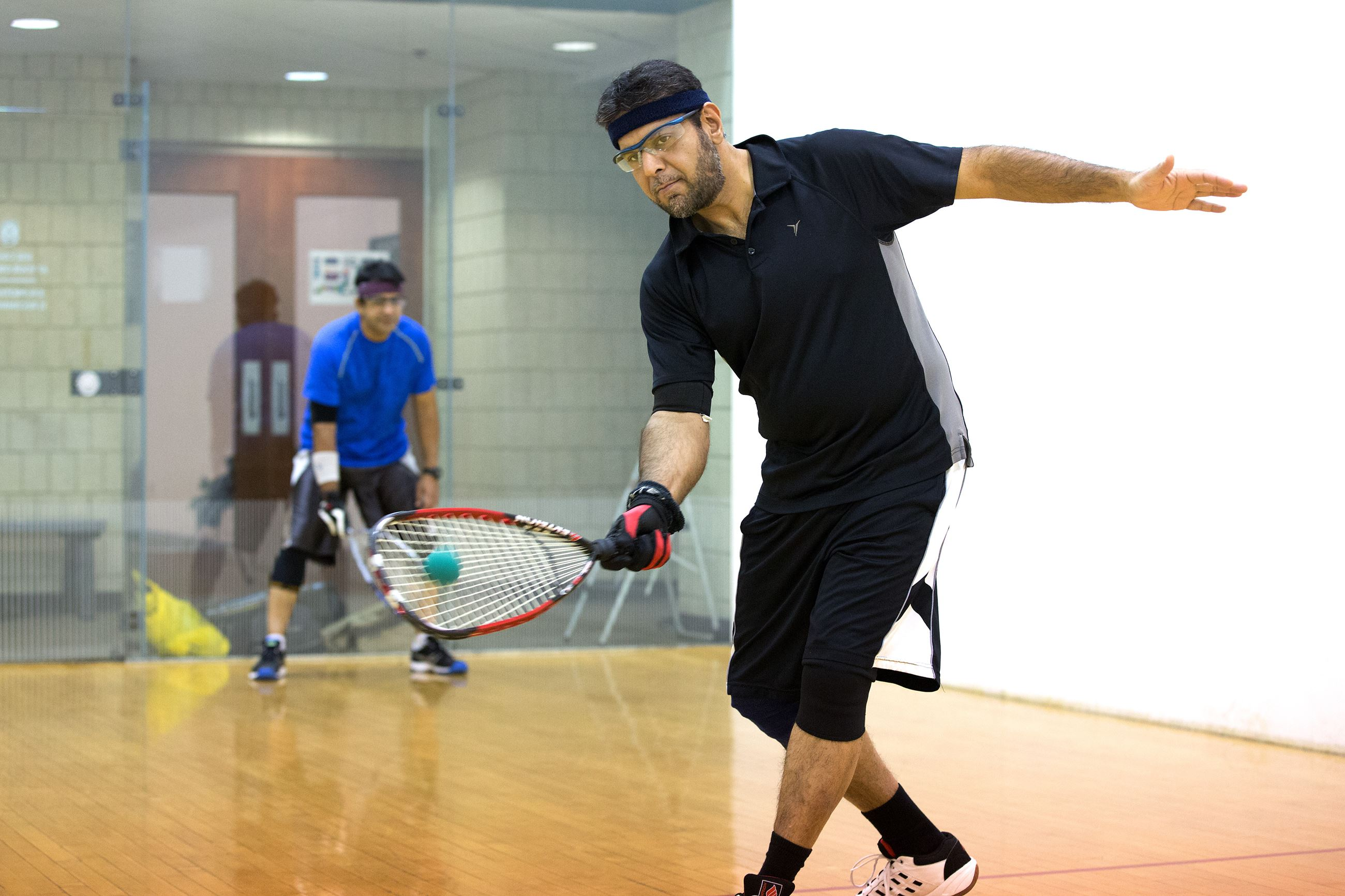 Two People on Racquetball Court